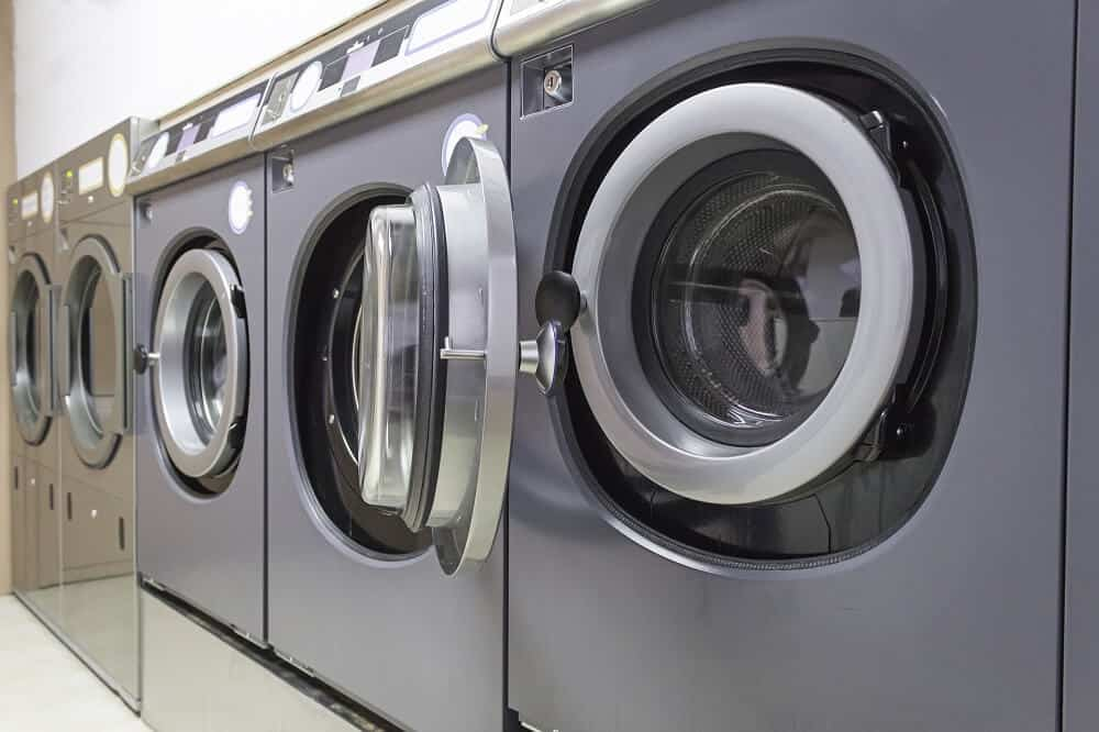 Row of washing machines in a laundromat, which could be a feasible small business opportunity in Singapore