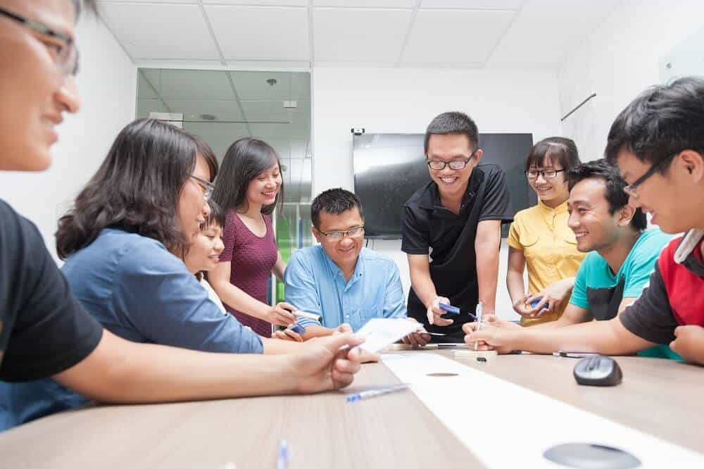 Company employees having a leadership training session funded by a business loan
